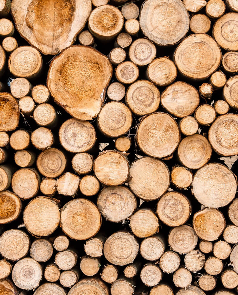 stack of blond wood logs comopz essential oil